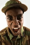 U.S. Soldier Dressed in Camouflage Angrily Shouting Commands